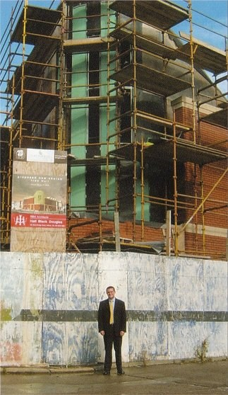Pastor Legge outside the new church building (under construction)